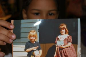Holding a photo of Mom's first day of Kindergarten on HER first day of Kindergarten! EveryMomDay.com